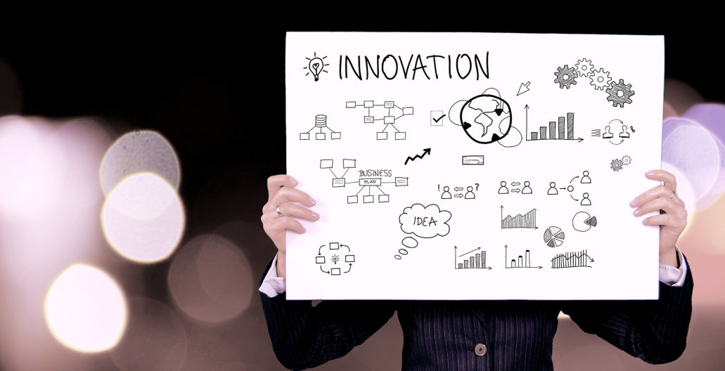 WOMAN HOLDING UP A INNOVATION GRAPHICAL CHART