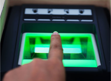 Biometric Device showing a users finger being scanned by the device
